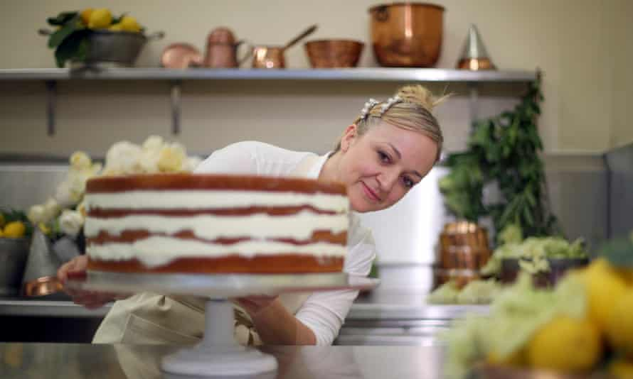 Claire Ptak puts the finishing touches to the royal wedding cake.