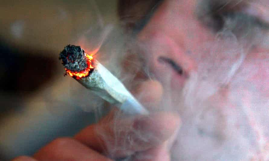 A file photo of an unidentified man smoking a cannabis cigarette