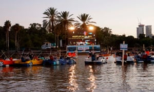 Israelis watch Paddington 2 while sitting in distanced pedal boats.