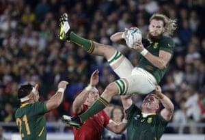 South Africa's R G Snyman wins a high ball under pressure from Alun Wyn Jones.