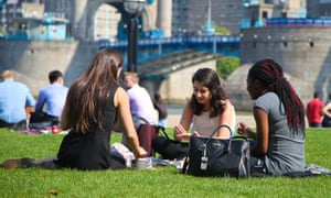 Women have lunch in the sunshine near City Hall, south-east London.