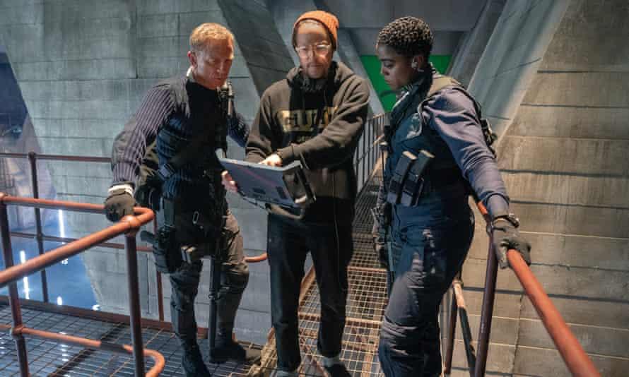 Director Cary Fukunaga with Daniel Craig (James Bond) and Lashana Lynch (Nomi) on the 007 sound stage at Pinewood Studios.