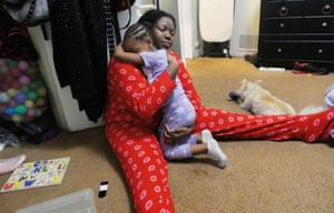 Lynnea, from Los Angeles, US, sitting on the floor hugging her daughter,  one of a series of self-portraits by people living with HIV