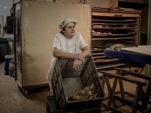 Martina Mateo with bread at her bakery in the village of Rillo de Gallo.