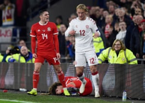 Connor Roberts clashes with Kasper Dolberg after his foul.