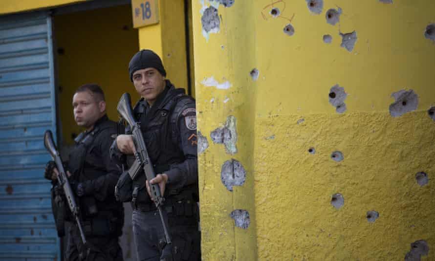 Military police stand guard in the Complexo de Alemão area of Rio de Janeiro