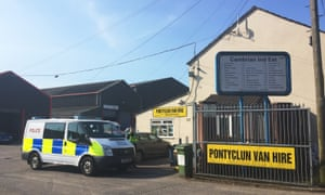 A police van outside Pontyclun Van Hire in Pontyclun, Mid Glamorgan, as a van hired from the company was found in Finsbury Park, north London, where one man has died, eight people taken to hospital and a person arrested after the vehicle struck pedestrians.