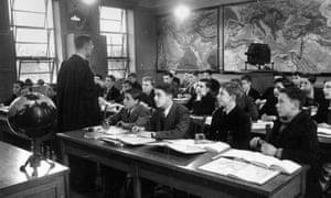Mr RH Walker teaches geography to a class of schoolchildren at Wigan Grammar School in Lancashire.