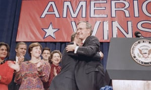 President-elect George HW Bush hugs his son George W Bush during his victory rally in Houston in November 1988.