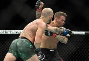 Conor McGregor punches Dustin Poirier.