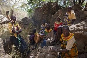 Former cutters from the Pokot tribe sit in Karamoja in Uganda.