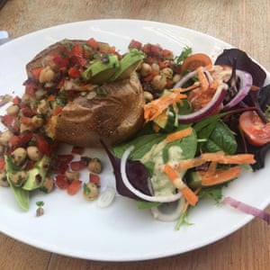 2 Spiced chickpea and smashed avocado jacket potato at Cafe Oswald's in Cranstons Penrith. The vegan option inside Cumbria's most famous butchers.