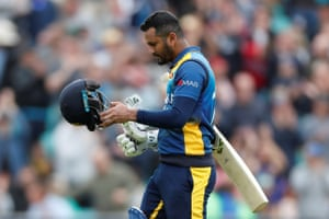 Dimuth Karunaratne looks dejected as he walks off after being caught.