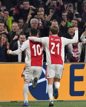Dusan Tadic celebrates with Frenkie de Jong after scoring from the penalty spot.