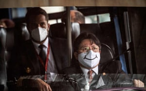 Bogotá, Colombia. A bus driver wears a face mask