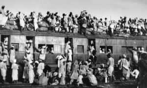 Muslim refugees sit on the roof of an overcrowded train near Delhi as they try to flee India in September 1947