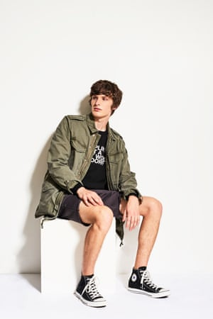 Model wears an army jacket and shorts