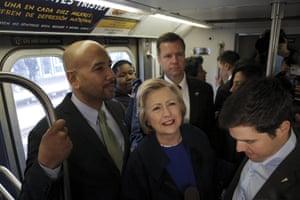 Hillary Clinton rides the New York City subway.
