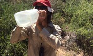 Scott Warren stops for a water break during an inspection of humanitarian supplies in Arizona's desert in 2015.