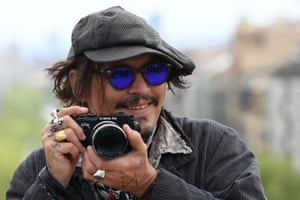 Johnny Depp takes pictures during the photocall for Minamata at the BCN Film Festival in Barcelona