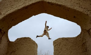 An Afghan boy plays in the ruins of a house that once belonged to the 13th-century Persian poet Rumi, on the outskirts of Mazar-i-Sharif.