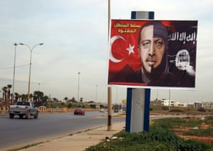 A billboard depicting the Turkish president Recep Tayyip Erdogan as a member of Islamic State in the eastern Libyan port city of Benghazi.