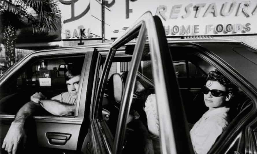 Gus Van Sant and Sandra Bernhard sitting in a car, being ridiculously cool