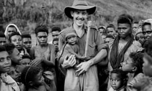 An Australian patrol officer holds a baby in Papua New Guinea in 1948. Australian members of the Royal Papua New Guinea constabulary, called kiaps, were withdrawn shortly after independence in 1975.