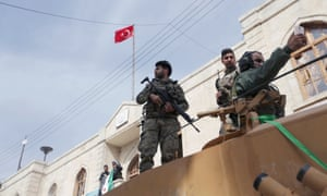 Turkish forces and Free Syrian Army troops in Afrin on Sunday.