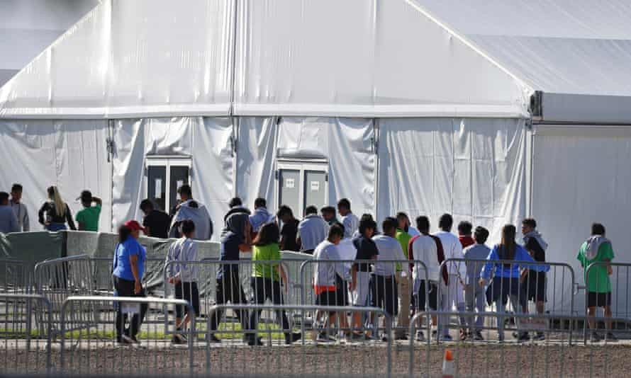 Children line up to enter a tent at the Homestead shelter for unaccompanied children in Homestead, Florida in February 2019.