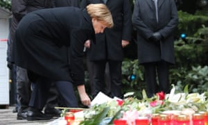 Chancellor Angela Merkel lays flowers at the attack scene.