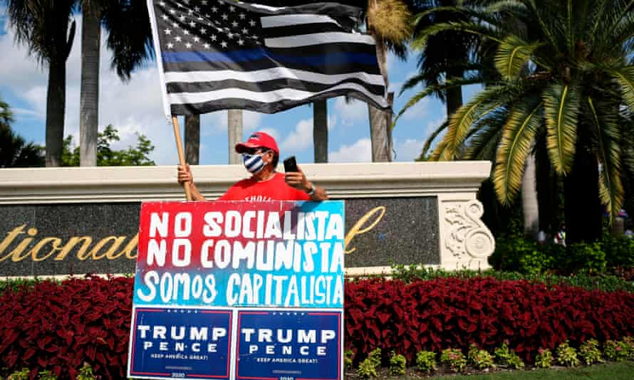 A Trump supporter rallies outside the Latinos for Trump even in Doral, Florida.