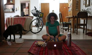 Ana Pereira of Caracas, Venezuela, joins a virtual picnic with her friends at home.