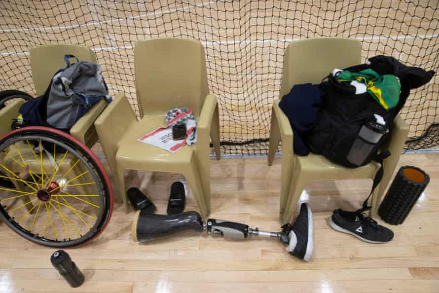 A prosthetic leg lies near the the players' belongings.