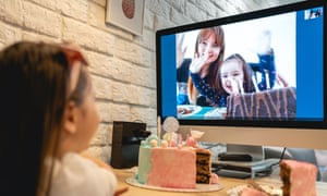 child blows out candles on birthday cake