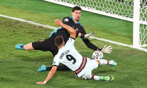 Belgium goalkeeper Thibaut Courtois saves from Andre Silva of Portugal.
