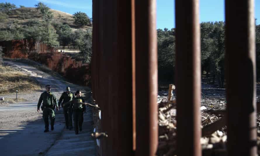 US border patrol agents at the US-Mexico border fence near Nogales, Arizona.