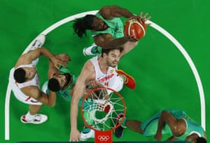 Spain's centre Pau Gasol jumps for the ball with Brazil's centre Nene Hilario during their men's round Group B basketball match at the Carioca Arena.