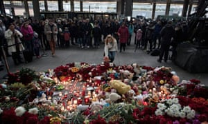 A woman lights a candle at Pulkovo international airport for the victims of the Russian MetroJet crash.