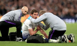 Jan Vertonghen is treated by Tottenham's doctors after the clash of heads against Ajax