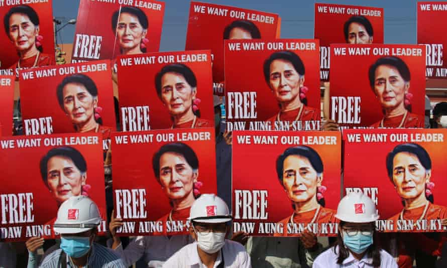 Demonstrators hold up placards calling for the release of detained Myanmar State Counselor Aung San Suu Kyi during a protest against the military coup in Naypyitaw, Myanmar