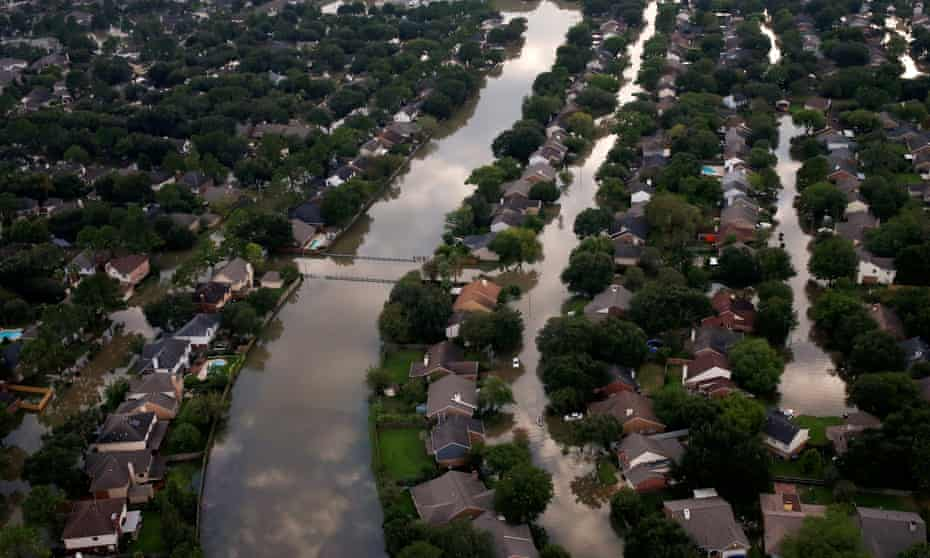 Houses are seen partially submerged in flood waters caused by Harvey in Houston, Texas on 30 August 2017.