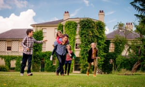 A family in the gardens at Down House, Kent, Charles Darwin's former home.