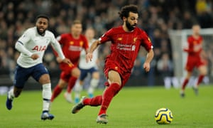 Mohamed Salah runs with the ball.