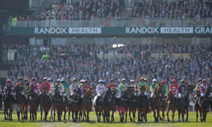 The horses line up for the start of last year's Grand National.