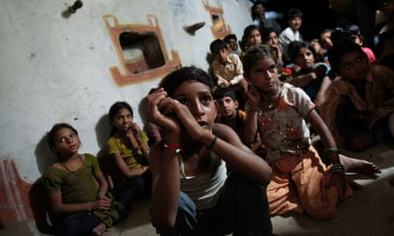 Children watch television powered by solar energy at Meerwada in the central Indian state of Madhya Pradesh.