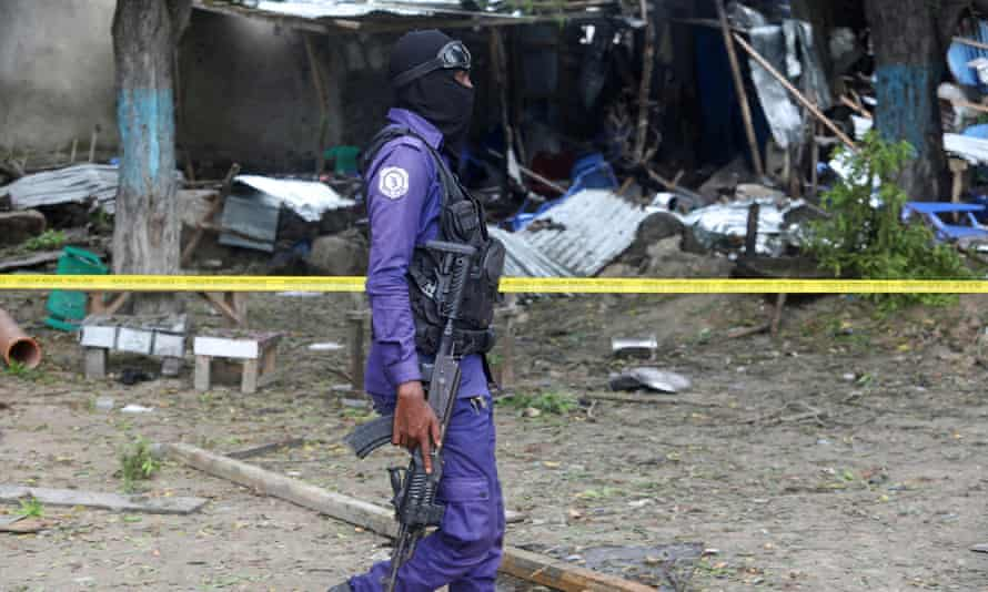 A Somali policeman at the scene of a previous suicide bombing in Mogadishu in November