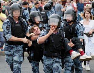 Riot police detain a protester in Moscow, Russia