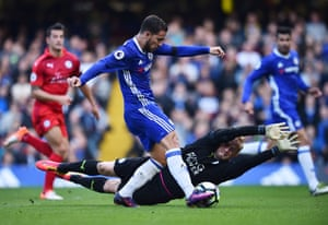Eden Hazard calmly puts the ball past Kasper Schmeichel.