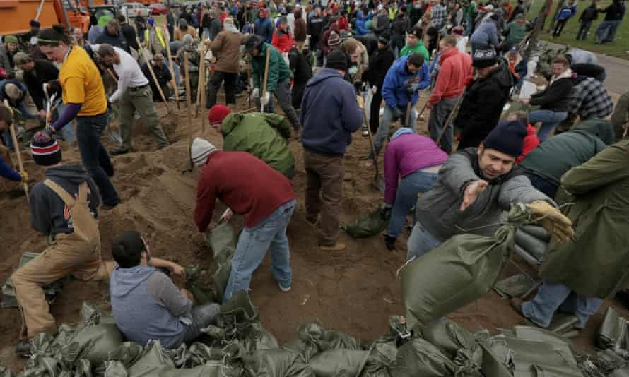 Hundreds of volunteers gather at River Des Peres Park on Tuesday to fill sandbags.